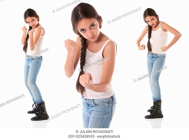 A beautiful young girl wants to fight. Isolated on white background