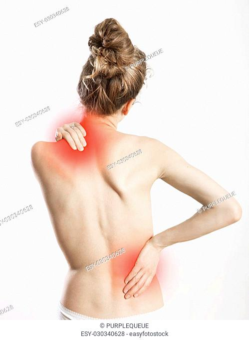 a young woman holds her back in pain, white background and exempted