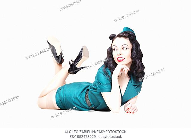 Portrait of Cute Sexy Brunette with black hair. Pin up Female Dressed in military clothing Uniform and Garrison cap with legs in the air