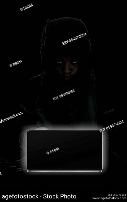 Hacker boy are hacking through the laptop on a black background