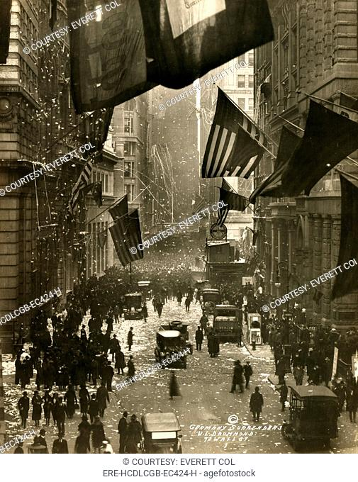 Old Glory. Flags wave over Wall Street, New York City in celebration of the surrender of Germany and the end of the Great War. W.L