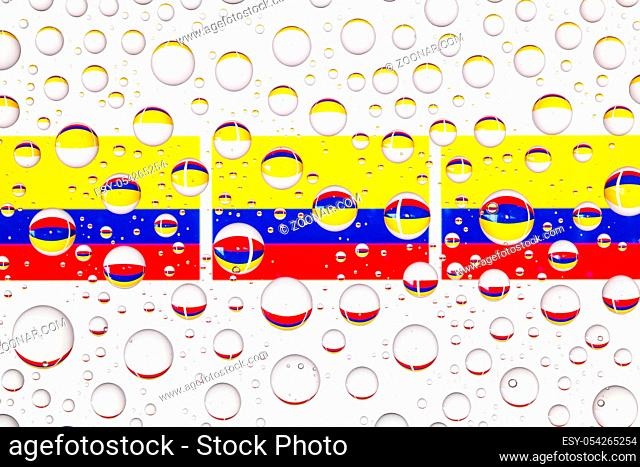 Flags of Colombia behind a glass covered with raindrops. 3D illustration