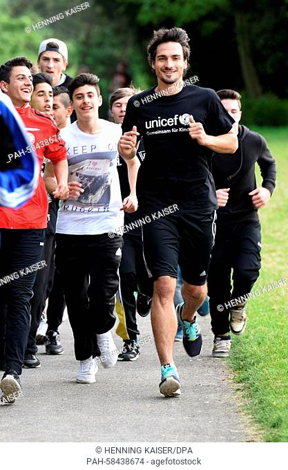 Soccer world champion Mats Hummels participates in a charity run of the United Nations Children's Fund UNICEF with children of the Henry Ford secondary school...