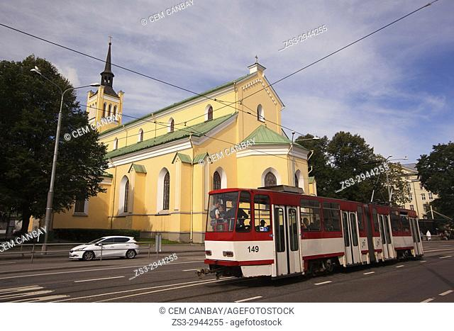 Tram in front of the St. John's Church in the old town, Tallinn, Estonia, Baltic States, Europe