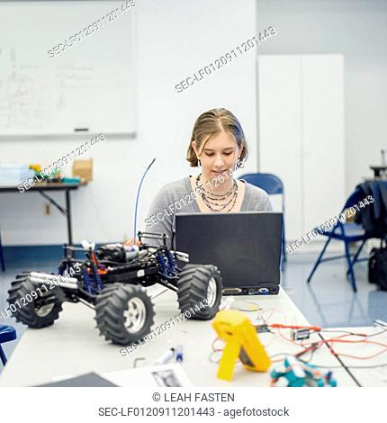 View of woman using laptop at work