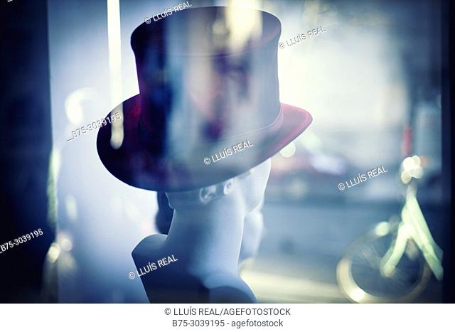 Later sight of the head of a manikin with top hat in a shop window. London, England
