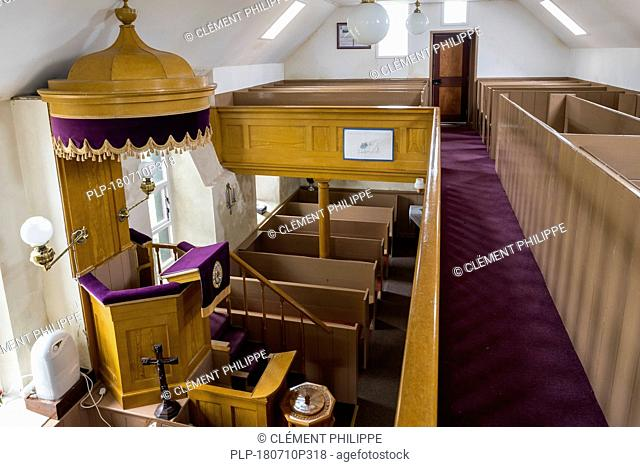 Interior showing wooden pulpit of 18th century Lunna Kirk / Lunna Church at Lunna Ness, Mainland, Shetland Islands, Scotland, UK