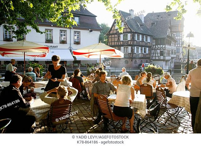 Sep 2008 - People sitting at an outdoors restaurant in Petite France, Strasbourg, Alsace, France
