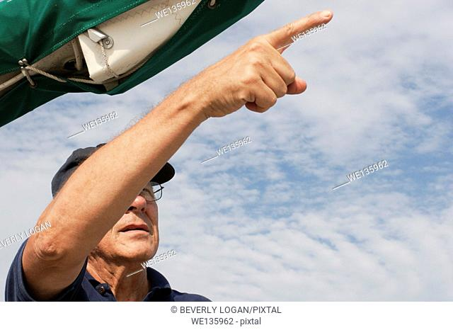 Senior man on a sailboat
