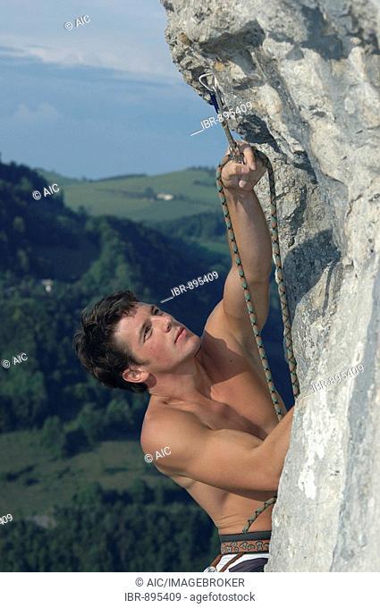 Climber reaching for a carabiner, Losenstein, Upper Austria, Austria, Europe
