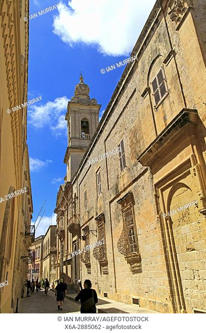 Historic buildings and Carmelite church and priory inside the medieval city of Mdina, Malta