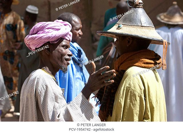 Men negotiating a deal at the Monday Market in Djenne, Mali