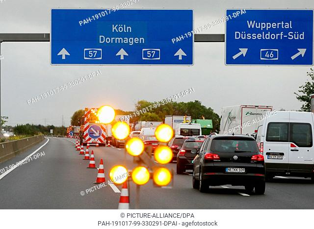 17 October 2019, North Rhine-Westphalia, Dormagen: Soap solution on the A57 near Dormagen leads to the complete closure of the A57 motorway