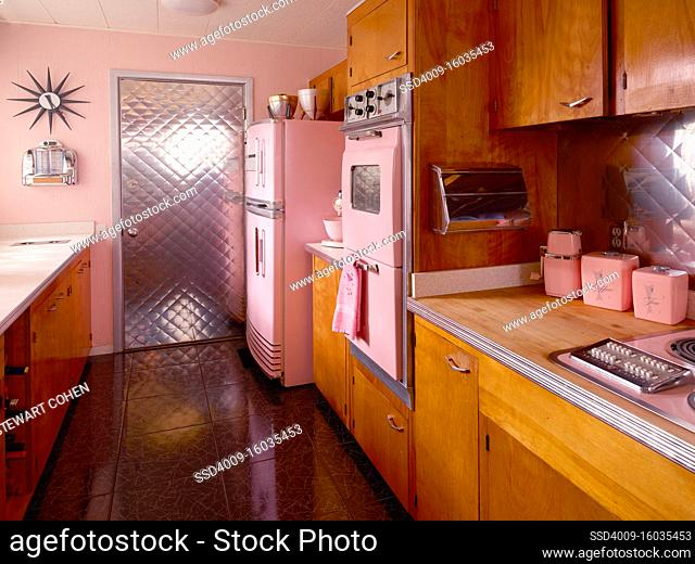 Mid century pink kitchen with pink appliances