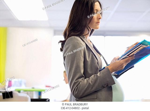 Pregnant businesswoman working in office