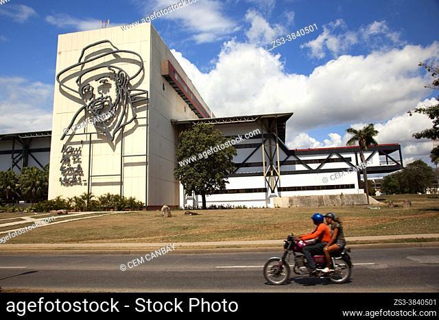 Motorcyclist in front of the Convention Center Heredia-Centro De Convenciones Heredia in the city center, Santiago De Cuba, West Indies, Central America