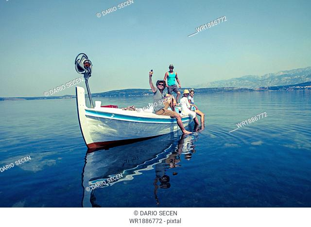 Croatia, Dalmatia, Young people in a boat, relaxing