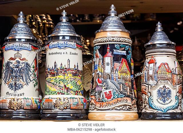 Germany, Bavaria, Romantic Road, Rothenburg-ob-der-Tauber, Shop Window display of Souvenir Beersteins