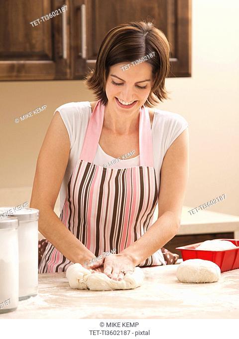 Woman preparing dough