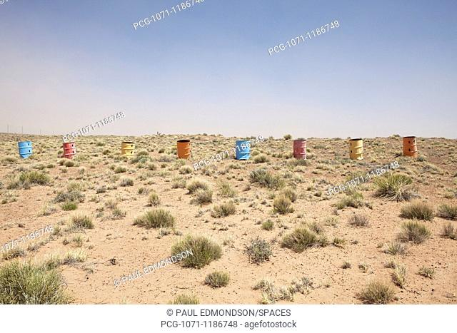 Colorful Row of Barrels in the Desert