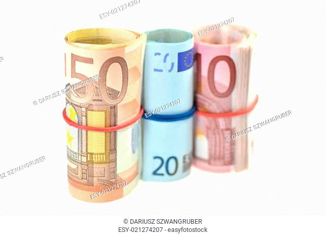 rolls of euro banknotes isolated on white