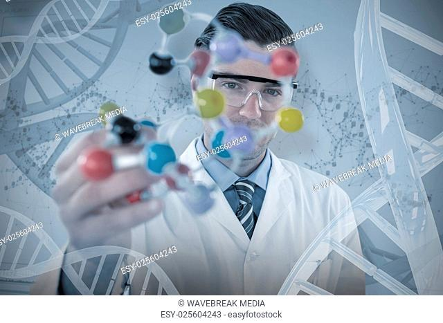 Composite image of portrait of scientist holding molecule structure