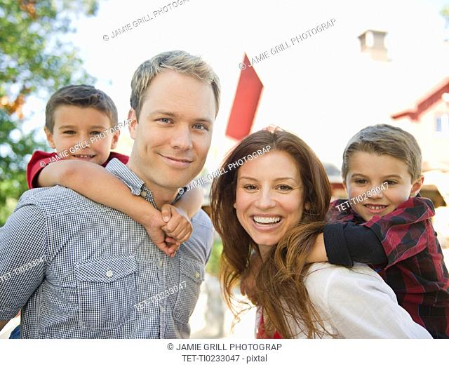 USA, New York, Flanders, Couple with two boys 4-5, 8-9 portrait