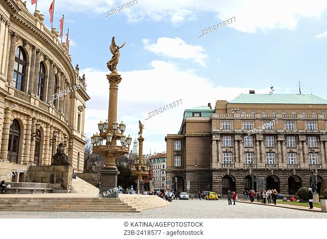 Charles University, the oldest university in Central Europe, and the concert hall Rudolfinum and its 'Golden Muse' column to the left, Prague, Czech Republic