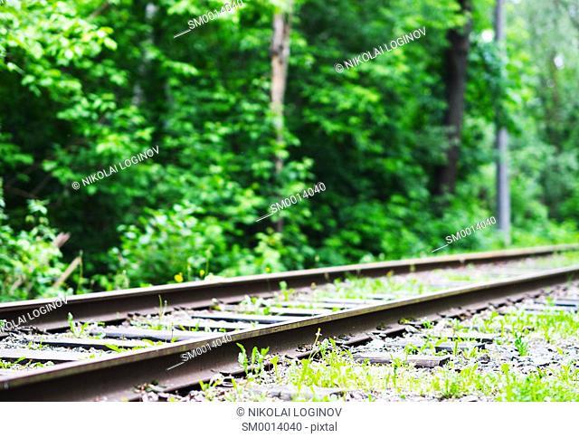 Diagonal old railroad track landscape background