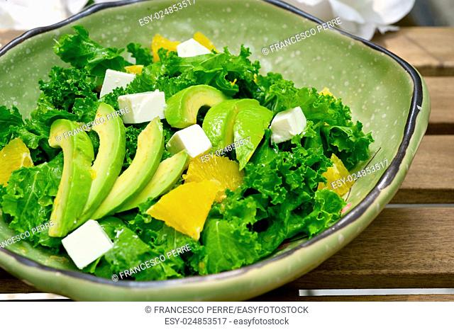 fresh avocado salad with orange pulp and feta cheese