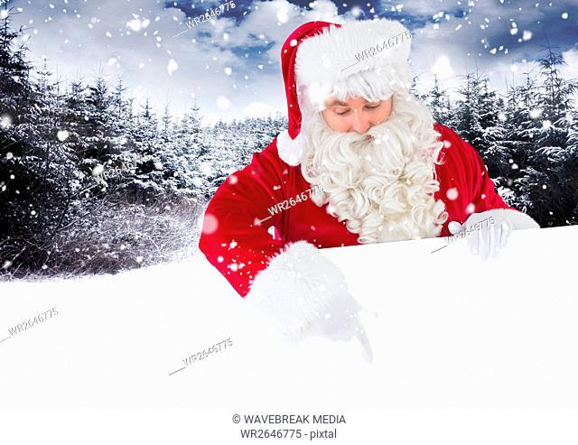 Santa claus looking down and pointing at white placard