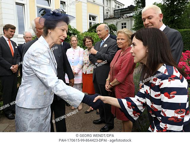 The British Princess Anne (L) and the actress Sibel Kekilli greet one another at the Anglo-German club in Hamburg, Germany, 15 June 2017