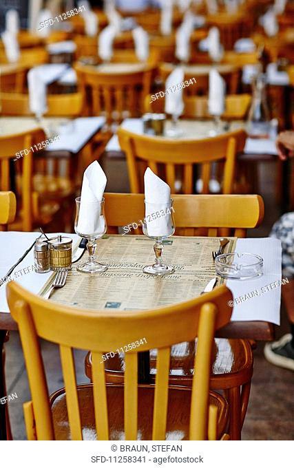 Tables laid in a restaurant