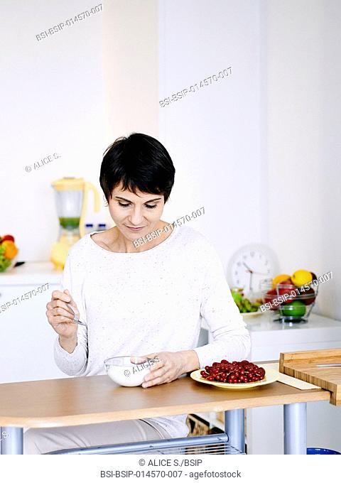 Woman eating cottage cheese
