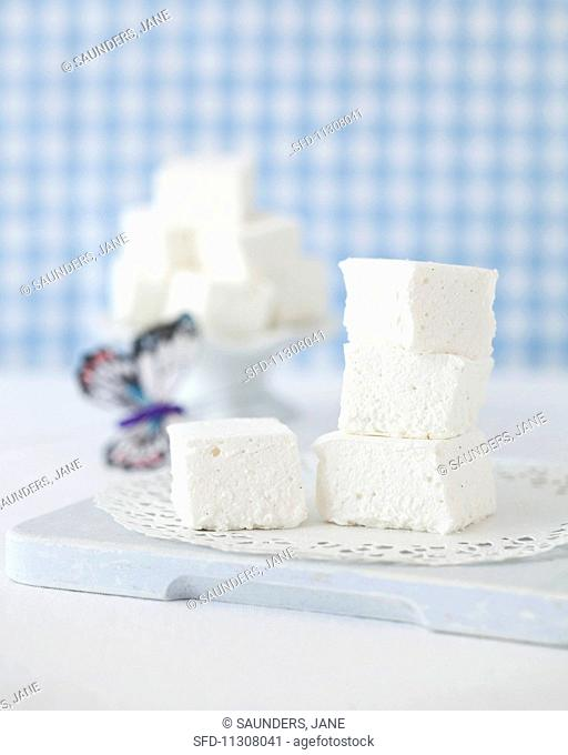 A stack of marshmallows on a doily