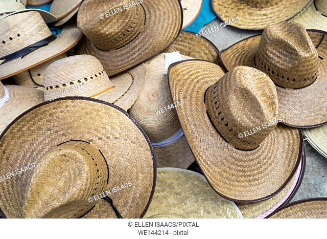 Assortment of straw hats on display at a Mexican market