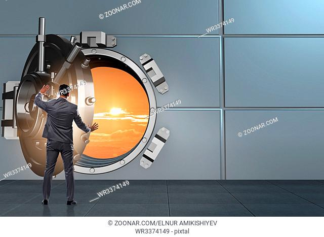 Businessman in banking concept with vault door