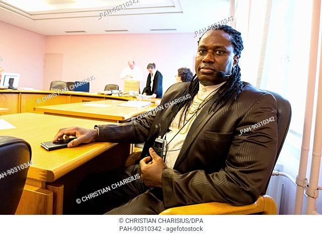 Friday Agbonlahor, interpreter for African languages from the interpreter and translator team 'Frisky Larr & Friends', at the regional court in Kiel, Germany