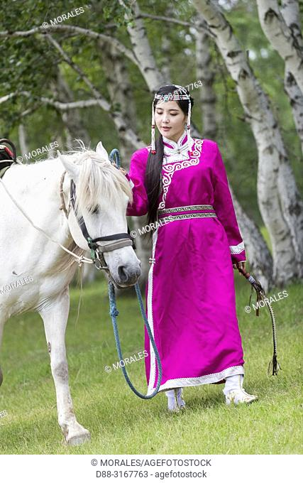 China, Inner Mongolia, Hebei Province, Zhangjiakou, Bashang Grassland, Mode, Mongol woman traditionnaly dressed with a horse,