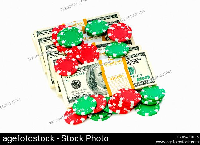 Dollar and casino chip stacks on white
