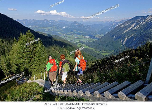 Hikers walking down the stairway leading to the Purtschellerhaus mountain hut on Hoher Göll mountain, Bayerischer Weg trail, Berchtesgadener Land district
