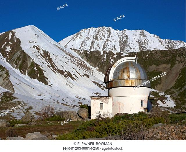 Observatory and snow covered mountains, Tien Shan Observatory, Ili Alatau N P , Tien Shan Mountains, Almaty, Kazakhstan, may