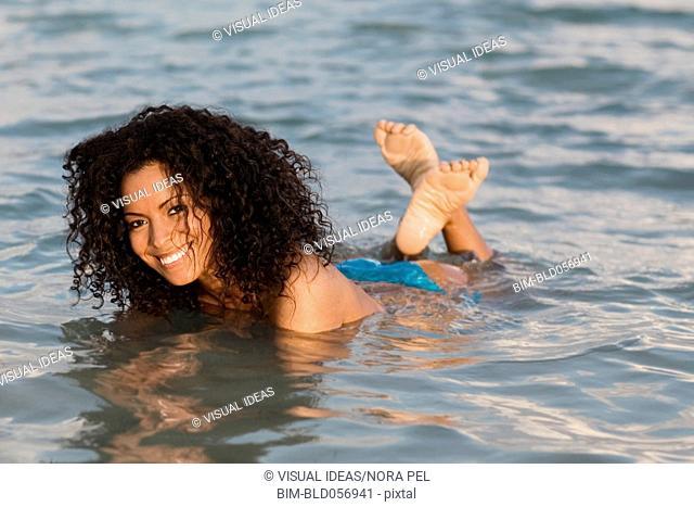 Hispanic woman in water