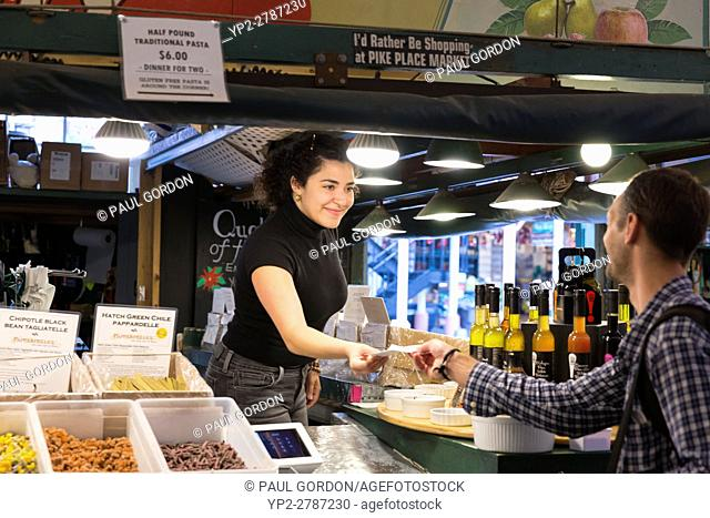 Seattle, Washington: Sophie helps a customer at Pappardelle's Pasta in Pike Place Market. Famous for its dark chocolate linguini
