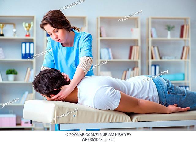 Female chiropractor doctor massaging male patient