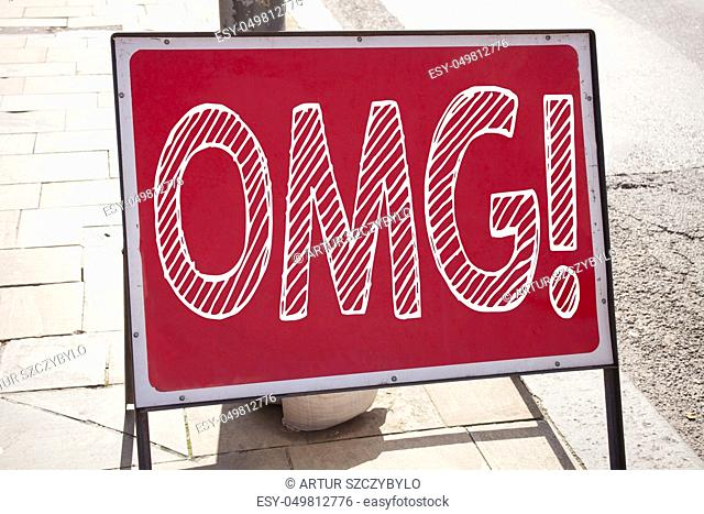 Conceptual hand writing text caption inspiration showing OMG Oh My God. Business concept for Surprise Humor written on announcement road sign with background...
