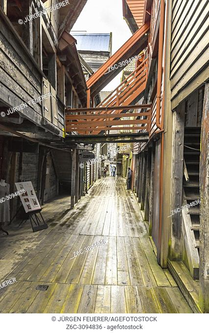 Old Hanseatic buildings of Bryggen in Bergen, Norway, inner view of a narrow lane with gallery