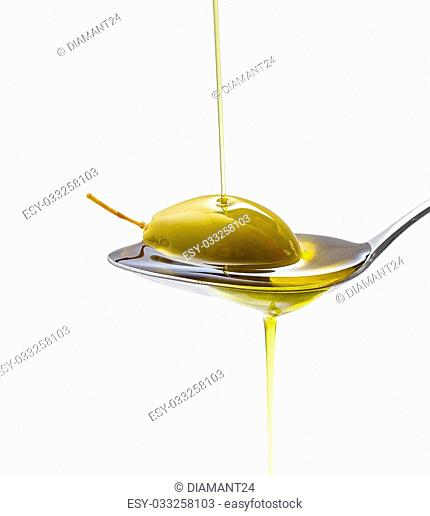 Green olive in full oil spoon on white background, isolated