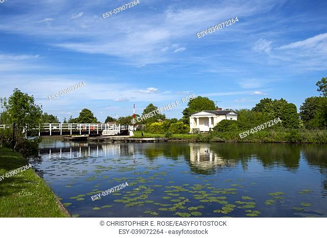 Late spring sunshine on Splatt Bridge and bridge keepers cottage on the Gloucester & Sharpness Canal at Frampton on Severn, Gloucestershire, UK