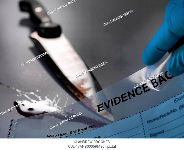 Bloody knife placed in evidence bag